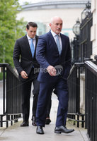 Press Eye - Belfast - Northern Ireland - 11th September 2020 - . Barry McGuigan pictured with Shane McGuigan as he heads into a High Court showdown with Carl Frampton in Belfast.. Mr Frampton, 32, is suing Mr McGuigan, his wife Sandra McGuigan and Cyclone Promotions (UK) Ltd, claiming a failure to pay purse money from his bouts.. Photo by Kelvin Boyes /  Press Eye.