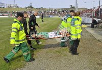 Press Eye - Belfast  - 11th August 2012. Danske Bank Premiership game between Glentoran and Donegal Celtic at The Oval, Belfast.. Glentorans Jim O\'Hanlon is stretchered off at Saturdays Danske Bank Premiership Game. . ©Russell Pritchard / Presseye