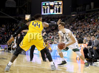Press Eye - Belfast -  Northern Ireland - 02nd December 2017 - Photo by William Cherry/Presseye. Manhattan College\'s Zane Waterman with Towson College\'s Alex Thomas during Saturday evenings Championship game of the Basketball Hall of Fame Belfast Classic at the SSE Arena, Belfast.  Photo by William Cherry/Presseye