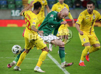 Press Eye - Belfast, Northern Ireland - 18th November 2020 - Photo by William Cherry/Presseye. Northern Ireland\'s Liam Boyce with Romania\'s Camora during Wednesday nights UEFA Nations League game at the National Football Stadium at Windsor Park, Belfast. Photo by William Cherry/Presseye