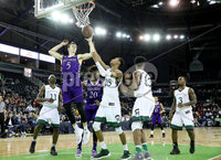 Press Eye - Belfast -  Northern Ireland - 01st December 2017 - Photo by William Cherry/Presseye. Manhattan College\'s Calvin Crawford with Holy Cross\'s Connor Niego during Friday afternoons Basketball Hall of Fame Belfast Classic game at the SSE Arena, Belfast.