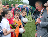 Press Eye - Belfast - Northern Ireland - 13th June 2018. As part of a two day visit to Northern Ireland Prince Charles and Camilla visited Owenkillew Community Centre, an established community facility based in the village of Gortin, Co Tyrone.  It opened in 1999 funded by Millennial Halls Grant and comprises a multi-use sports hall, meeting room, gym & playgroup with a Men's Shed being added in 2016.  It is set on a 7 acre site which also comprises a 55 bed hostel, 4 town houses, an outdoor Activity Centre, community garden, MUGA, footgolf course and is a key link for the village.. Prince Charles meets local children including those involved in GAA. . . Picture by Jonathan Porter/PressEye