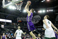 Press Eye - Belfast -  Northern Ireland - 01st December 2017 - Photo by William Cherry/Presseye. Manhattan College\'s Patrick Strzala and Zane Waterman with Holy Cross\'s Matt Faw during Friday afternoons Basketball Hall of Fame Belfast Classic game at the SSE Arena, Belfast.