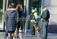 Press Eye - Belfast - Northern Ireland - 9th December 2019. PSNI officers and sniffer dog enter Belfast Laganside Courts where they conducted an anti-drugs operation. . Picture by Jonathan Porter/PressEye