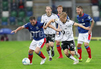Press Eye - Belfast -  Northern Ireland - 10th July 2019 - Photo by William Cherry/Presseye/Inpho. Linfield\'s Jamie Mulgrew with Rosenborg\'s Birger Meling during Wednesday nights Champions League, Qualifying First Round, 1st Leg game at the National Stadium at Windsor Park, Belfast.