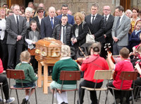 Press Eye Belfast - Northern Ireland 19th May2017. Funeral of Concepta Leonard in Brookeborough, Co. Fermanagh.  The 51-year-old died after after being attacked by her former partner on Monday in Maguiresbridge on Monday.  Peadar Phair then went on to kill himself at the scene.  Mrs Leonard\'s 30-year-old son Conor, who has Down\'s syndrome, was injured while trying to protect his mother went on to raise the alarm.  . Mrs Leonard\'s coffin stands outside St Mary\'s Church in Brookeborough after require mass as young children she taught music play some songs, as family and friends look on. . Picture by Jonathan Porter/PressEye.com
