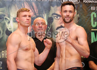 Press Eye - Belfast - Northern Ireland - 29th June 2018. Weigh in at the Europa Hotel in Belfast ahead of Michael Conlan\'s homecoming fight against Brazilian Adeilson Dos Santos at the SSE Arena on Saturday night. . Left to right.  harry Matthews and Padraig McCrory go head-to-head after the weigh in . Picture by Jonathan Porter/PressEye