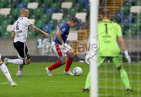 Press Eye - Belfast -  Northern Ireland - 10th July 2019 - Photo by William Cherry/Presseye/Inpho. Linfield\'s Jamie Mulgrew with Rosenborg\'s Tore Reginiussen and Andre Hansen during Wednesday nights Champions League, Qualifying First Round, 1st Leg game at the National Stadium at Windsor Park, Belfast.