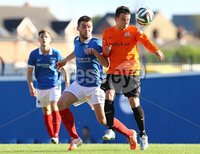 20th September 2014 ©William Cherry / Presseye. Linfield\'s Stephen Lowry with Glenavon\'s Shane McCabe during Saturdays Danske Bank Premiership game at Windsor Park, Belfast.