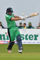Mandatory Credit: Rowland White / PressEye. Cricket: Walton Tri-Series International. Teams: Ireland (light green) v Bangladesh (dark green). Venue: Malahide. Date: 19th May 2017. Caption: Barry McCarthy goes for it