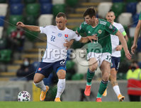 Press Eye-Belfast-Northern Ireland -12th November 2020. National Football Stadium at Windsor Park, Belfast. . 12/11/2020. Northern Ireland  Patrick McNair  and Slovakia Stanislav Lobotka  during Thursday  night\'s UEFA Euro 2020  Play-off Final  at the National Football Stadium at Windsor Park,Belfast.. Mandatory Credit PressEye