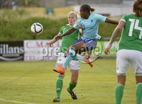 Press Eye - Belfast - Northern Ireland - 8th June. World Cup qualifier - Northern Ireland  v Netherlands at Shamrock Park Portadown.. Northern Irelands Julie Nelson  in action with Netherlands  Sherida Spritse. Mandatory Credit: Presseye/Stephen Hamilton