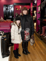 ©Press Eye Ltd - Northern Ireland - 10th December 2011. Mandatory Credit - Photo by Andrew Paton/Presseye.com, Launch of Carin\'s brand new boutique. Mary McCann with her daughter seven year old Katie Rose McCann