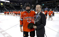 Press Eye - Belfast, Northern Ireland - 29th November 2019 - Photo by William Cherry/Presseye. Steve Hagwell, ECAC Hockey Commissoner presents Princeton\'s Spencer Kersten with the man of the game award after Friday evenings Friendship Four game against Colegate Raiders at the SSE Arena, Belfast. Photo by William Cherry/Presseye