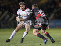 Guinness PRO14, Rodney Parade, Newport, Wales 1/12/2017. Dragons vs Ulster. Ulster\'s Louis Ludik evades the tackle of Dragons\' Adam Warren. Mandatory Credit ©INPHO/Bob Bradford