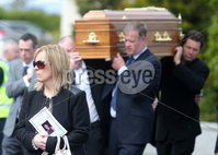 Press Eye Belfast - Northern Ireland 19th May2017. Funeral of Concepta Leonard in Brookeborough, Co. Fermanagh.  The 51-year-old died after after being attacked by her former partner on Monday in Maguiresbridge on Monday.  Peadar Phair then went on to kill himself at the scene.  Mrs Leonard\'s 30-year-old son Conor, who has Down\'s syndrome, was injured while trying to protect his mother went on to raise the alarm.  . Family and friends carry Mrs Leonard\'s coffin from the family home in Brookeborough to St Mary\'s Church in the town for require mass. . Picture by Jonathan Porter/PressEye.com