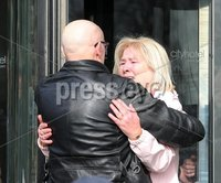 Press Eye Northern Ireland. Thursday 14th March 2019. . Bloody Sunday families leaving the City Hotel following the briefing with the Department of Public Prosecutions.. Eamon McCann comforts Lina Nash.. Photo Lorcan Doherty/Presseye