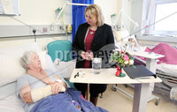 Press Eye - Belfast - Northern Ireland - 5th March 2018 -  . Visiting Londonderry on Monday 5 March 2018, Secretary of State for Northern Ireland Karen Bradley MP toured Altnagelvin Area Hospital\'s A&E unit and visited the hospital's Cardiology and Orthopaedic Wards to meet clinical leads and patients and hear first-hand about the care the hospital provides as well as the challenges faced by the health sector.. Secretary of State for Northern Ireland Karen Bradley is pictured with patient Grace Fraser during her visit to the hospital.. Photo by Kelvin Boyes / Press Eye..
