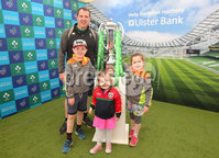Press Eye - Belfast - Northern Ireland - 16th May 2018. First day of the 2018 Balmoral Show, in partnership with Ulster Bank, at Balmoral Park.  Ulster Bank has the NatWest Six Nations trophy at its stand over the four days of this year's Balmoral Show. Visitors to the show today had the chance to have their photo taken with the trophy which Ireland claimed this year as part of their Grand Slam success. Pictured with the trophy are Miceal Doyle from Ballyward and his children Eoin(8), Clara(6).  and Rose(3).. . Picture by Jonathan Porter/PressEye