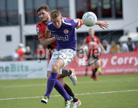 24th August 2019. Danske Bank Premiership. Seaview Belfast. Crusaders v Larne. Crusaders Philip Lowry in action with Larnes Jeff Hughes. Mandatory Credit : Stephen Hamilton/Inpho