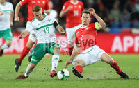 Press Eye - Belfast -  Northern Ireland - 12th November 2017 - Photo by William Cherry/Presseye. Northern Ireland\'s Jamie Ward with Switzerland\'s Stephan Lichtsteiner and Yann Sommer during Sunday nights World Cup Play Off 2nd leg game at St. Jakob-Park, Basel.