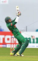 Mandatory Credit: Rowland White / PressEye. Cricket: Walton Tri-Series International. Teams: Ireland (light green) v Bangladesh (dark green). Venue: Malahide. Date: 19th May 2017. Caption: Soumya Sarkar tips one to the boundary