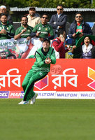 Mandatory Credit: Rowland White / PressEye. Cricket: Walton Tri-Series International. Teams: Ireland (light green) v Bangladesh (dark green). Venue: Malahide. Date: 19th May 2017. Caption: Ireland\'s George Dockrell takes a boundary catch to dismiss Sabbir Rahman of Bangladesh