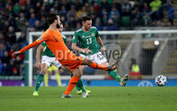 Press Eye - Belfast, Northern Ireland - 16th November 2019 - Photo by William Cherry/Presseye. Northern Ireland\'s Corry Evans with Netherlands\' Davy Propper during Saturday nights UEFA Euro 2020 Qualifier at the National Stadium, Belfast.     Photo by William Cherry/Presseye