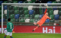 Press Eye - Belfast, Northern Ireland - 18th November 2020 - Photo by William Cherry/Presseye. Northern Ireland\'s Bailey Peacock-Farrell makes a great save against Romania during Wednesday nights UEFA Nations League game at the National Football Stadium at Windsor Park, Belfast. Photo by William Cherry/Presseye