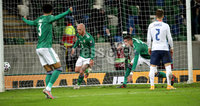 Press Eye - Belfast, Northern Ireland - 12th November 2020 - Photo by William Cherry/Presseye. Northern Ireland\'s Jamal Lewis, Liam Boyce and Kyle Lafferty celebrate scoring against Slovakia during Thursday nights UEFA Euro 2020 Play-Off Final at the National Football Stadium at Windsor Park.   Photo by William Cherry/Presseye