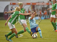 Press Eye - Belfast - Northern Ireland - 8th June. World Cup qualifier - Northern Ireland  v Netherlands at Shamrock Park Portadown.. Northern Irelands Julie Nelson  in action with Netherlands  Siri Worm. Mandatory Credit: Presseye/Stephen Hamilton