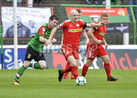 4th August 2018. Danske Bank Irish premier league match between Glentoran and Cliftonville at The Oval in Belfast.. Glentorans Peter McMahon  in action with Cliftonvilles Ryan Catney.  Mandatory Credit: Stephen Hamilton /Inpho