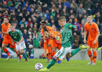 Press Eye - Belfast - Northern Ireland - 16th November 2019. UEFA EURO 2020 Qualifier Group C.  Northern Ireland Vs Netherlands at the National Stadium at Windsor Park, Belfast. . Northern Ireland captain Steven Davis takes a penalty which he fails to score at Netherlands captain Virgil van Dijk looks on. . . Picture by Jonathan Porter/PressEye