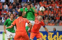©Press Eye Ltd Northern Ireland - 1st June 2012. Mandatory Credit - Picture by Darren Kidd/Presseye.com .  . Netherlands v Northern Ireland at the Amsterdam Arena.. Northern Ireland\'s Daniel Lafferty with Holland\'s Robin van Persie and Mark van Bommel