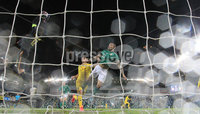 Press Eye-Belfast-Northern Ireland -18th November 2020. National Football Stadium at Windsor Park, Belfast. . 18/11/2020. Northern Ireland  Josh Magennis    and Romania goal keeper Ciprian Tatarusanu   during Wednesday   night\'s UEFA Nations League match at the National Football Stadium at Windsor Park,Belfast.. Mandatory Credit PressEye