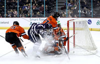 Press Eye - Belfast, Northern Ireland - 30th November 2019 - Photo by William Cherry/Presseye. Princeton Tigers\' Ryan Ferland with UNH Wildcats\' Kohei Sato during Saturday afternoons Friendship Four game at the SSE Arena, Belfast.      Photo by William Cherry/Presseye
